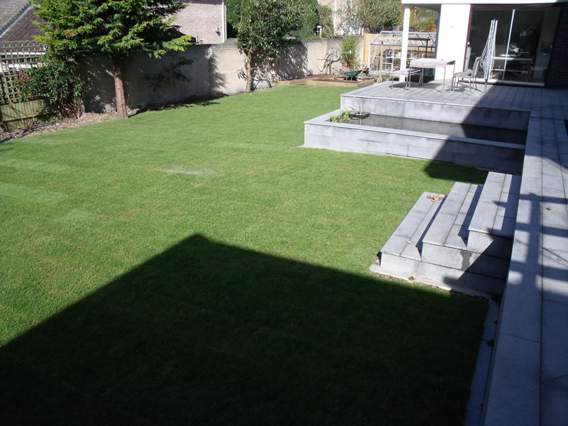 Rear Garden With Granite Paving With Formal Pond and Waterfall